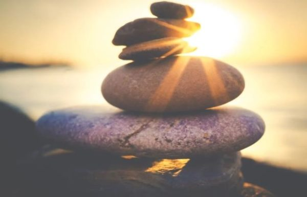 Consciously Living - Your NZ Wellness Directory - sun rays on stones